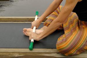 Massage du pied au bâton